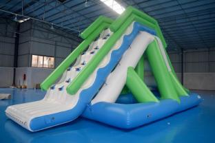 Customized 0.9mm PVC Tarpaulin Inflatable Floating Water Slide For Commercial Use